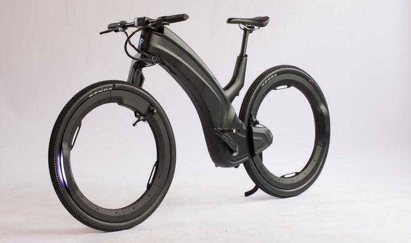 Велосипед с колесами без спиц на электротяге